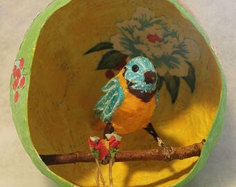Paper mache yellow and blue bird and nest