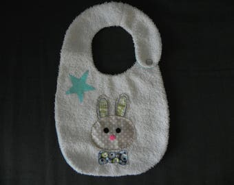 White Terry cloth bib, applied rabbit bow tie