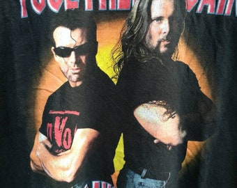 On sale vintage 90s wrestling NWO/WCW run with the pac/vintage shirt/printed shirt/black shirt