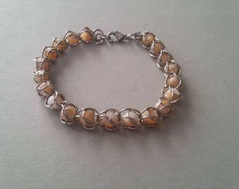 Bracelet round cages beads
