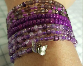 Purple beads memory wire bracelet with butterfly charm