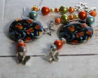 Black, orange, lime green, turquoise beads and silver metal charms earrings