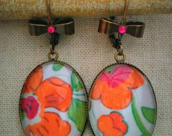 Cabochons and bronze colored metal dangling earrings