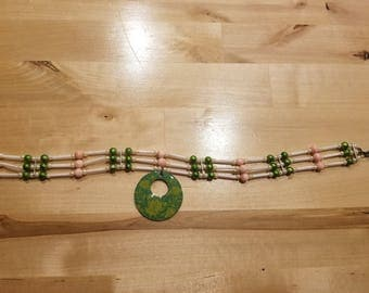 Pink and green choker necklace with green floral charm