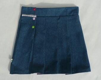 Girl schoolgirl pleated denim skirt.