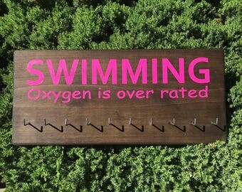 wood signs/ swimming ribbon holder