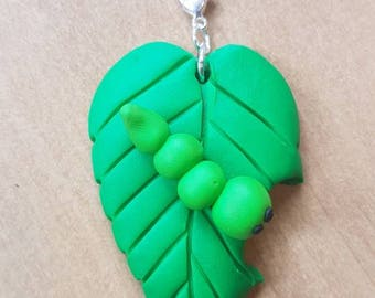 Little polymer clay leaves with a hungry caterpillar