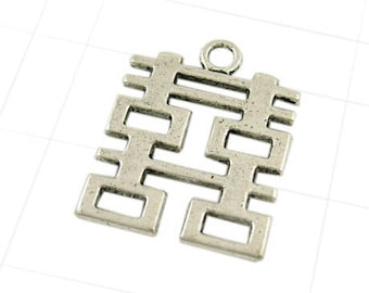 A silver pendant, 31.5 x 24.5 mm, thickness 2 mm, hole 3 mm