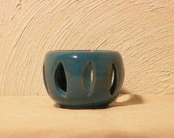 Turquoise blue candle