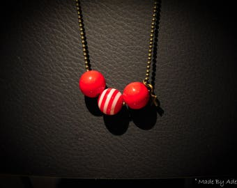 Necklace of brass and red beads