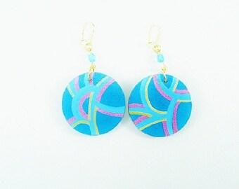 On earrings, dangle earrings multicolor turquoise background