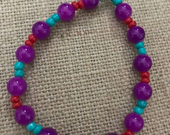 Purple glass beaded bracelet with red and teal beads