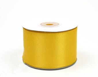 25 meters of 50 mm ref 645 wide yellow satin ribbon