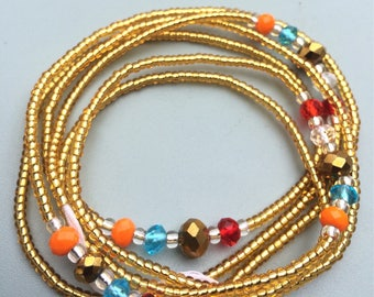 African waist beads. Custom fit. Yellow, topaz, orange, blue and crystal beads