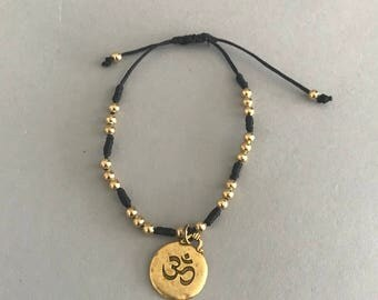 Knotted bracelet with beads, Om, Love, peace