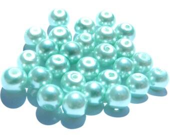 24 perles verre nacré bleue verte pastel de 6 mm.
