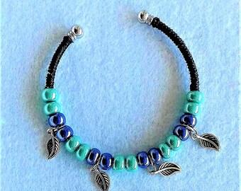 Stiff bracelet with charms
