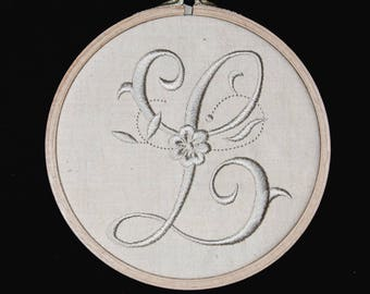L: your initial.  Beautiful embroidery that evokes the old linen.