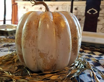 White artificial pumpkin with gold leaf