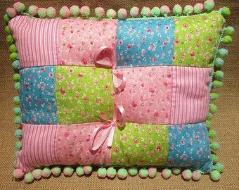 Pink blue green rectangular patchwork pillow