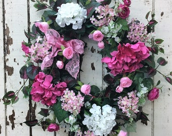 Valentine's Day Wreath with Hot Pink Hydrangea, Light Pink Lilac, White Hydrangeas, Pink Mini Roses. Cream Viburnum and a Pink Lace Bow