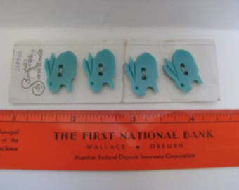 Four teal bunny/rabbit buttons