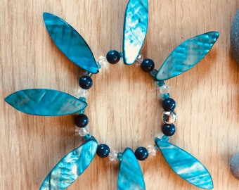 Bracelet with Shell Leaves and blue beads.