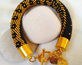 Bracelet with gold ornament