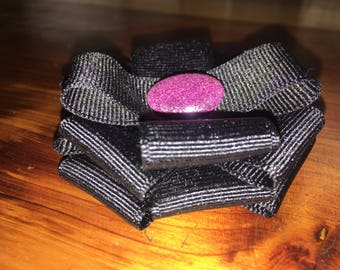 Black flower with pink glitter center