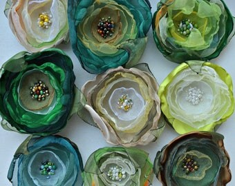 One green organza flower pin