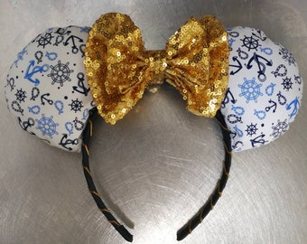 Nautical sailor minnie ears with gold bow.
