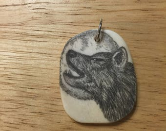 Howling wolf pendent