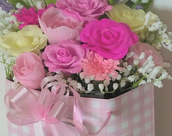 Its a girl! Floral paper arrangement sitting in a pretty pink and white gift bag