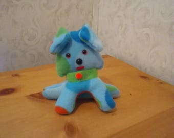 Puppy for children in fleece multicolor pokadot. Safety eyes n nose. Velcro collar. Hypoallergenic stuffing. Measures 6 inches high.