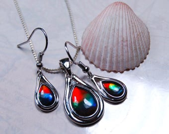 Ammolite set of pendant and earring/dangles.Bright top grade rainbow gems will impress and delight.#081017