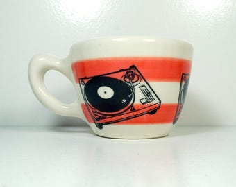 a 12oz cup painted in red-orange stripes with Turntable prints READY to SHIP