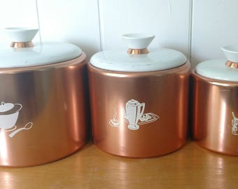 vintage copper color mid century aluminum canister set