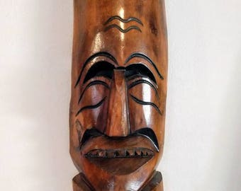 Smiling Polynesian Carved Wooden Art