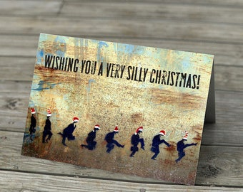 Ministry of Silly Christmas card - Xmas Monty Python's Ministry of Silly Walks red santa hats stencil graffiti humor funny street art 70s tv