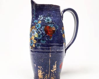 Poppy pitcher with glossy blue glaze and blue flowers