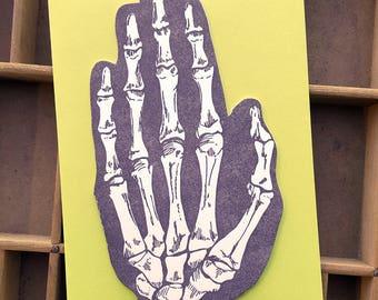 letterpress skeleton hand shaped card