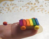 Reserved for Amanda B ONLY. Rainbow Xzylophone and Rainbow Stacking Rings