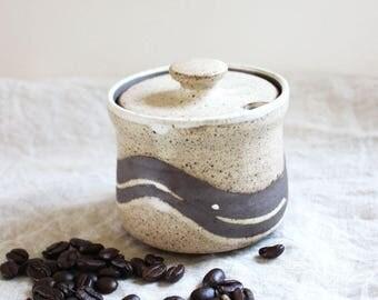Vintage stoneware lidded jam jar or honey pot. Rustic studio pottery.