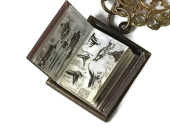 Leonard Da Vinci Illustrated Manual Hidden Book Necklace with Tiny Readable Book Charles Dickens Author