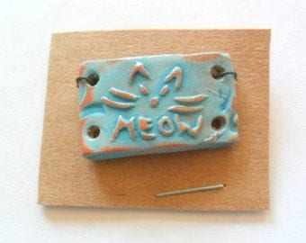 Small Curved Kitty Cat Turquoise Glazed Terra Cotta Link Finding