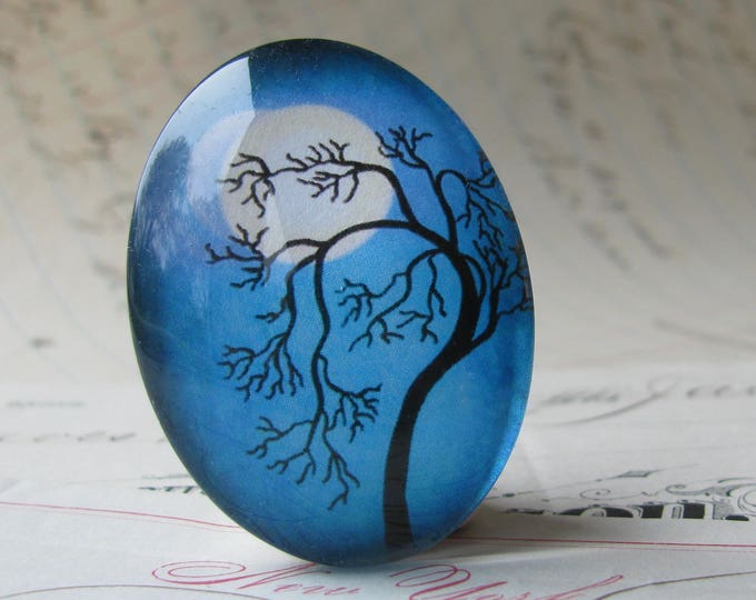 Tree silhouette against a full moon, 40x30mm handmade glass oval cabochon, blue sky, night sky, twilight, from or Mystic Moon collection