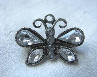 Sweet little silver tone butterfly brooch pin with crystal accents
