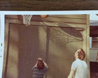 Basketball with child in the drive.