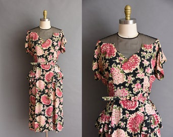 Gorgeous vintage 1940s black and pink floral print rayon dress with a sheer cutout neckline
