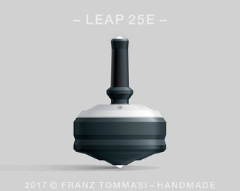 LEAP 25E White-on-Black Spin Top with white cover over black body, ergonomic stem with rubber grip, dual ceramic tip, and 3 accent holes